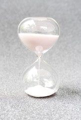 Time count by sand clock in the glass