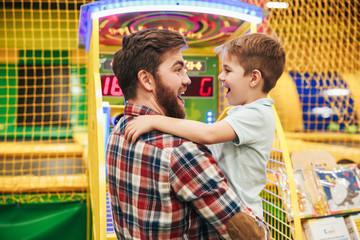 Cute little boy having fun with his dad
