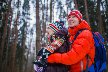 Photo of happy couple on walk in winter forest