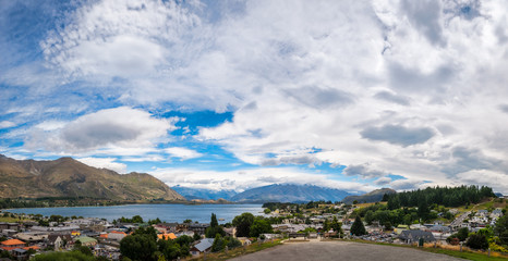 View of Wanaka lake and alpine resort town with  the mountain range in the background from the Wanaka War Memorial.