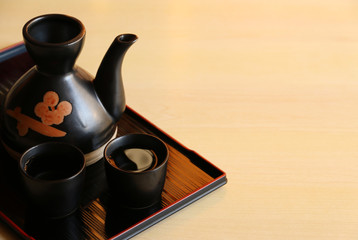 japanese sake on wooden table Copy space