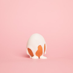 Coloring Easter Egg, Vibrant white  Paint pouring over an egg is