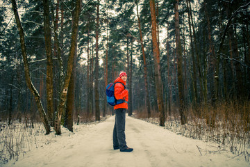 Image of man with backpack in winter forest