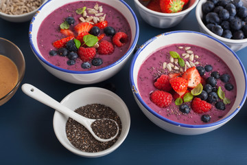 healthy berry smoothie bowl with strawberry blueberry raspberry and chia seed