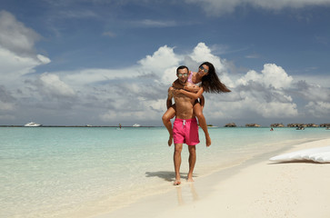 love story photo of beautiful couple in honeymoon relaxing in Maldives island