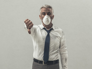 Businessman with pollution mask