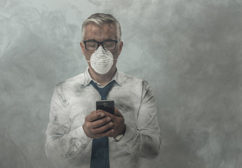 Businessman having a phone call and toxic smog