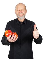 Ripe pomegranate in happy man's hands