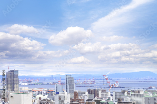 e4e49901fb1 Cityscapes of Kobe city with blue sky and fluffy tiny clouds ...