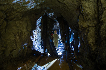 Underground abandoned ore mine shaft tunnel gallery with scary horror monster zombie