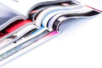 Stack of magazines on white background or isolated
