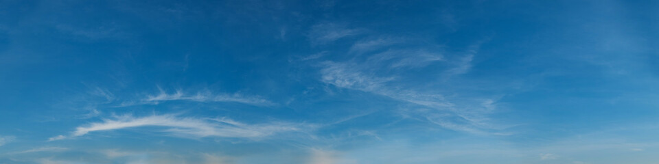 Vibrant color panoramic sky with cloud on a sunny day. Beautiful cirrus cloud. Panorama  photograph.