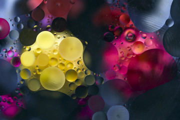 On an abstract blue background yellow and red spots