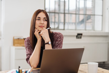 Thoughtful businesswoman sitting looking
