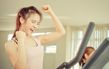 Asian woman celebrate on her successfully workout