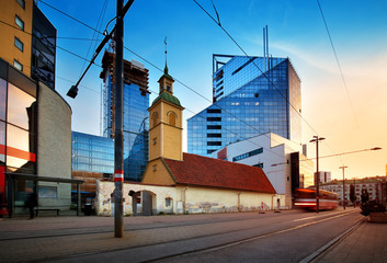 Wall Mural - View to Tallinn in late evening in summer. Estonian capital. City landscape with tram on the road and modern buildings