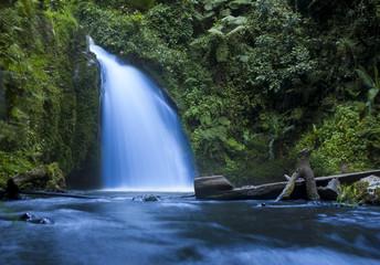 Waterfall in tropical jungle in Mt Kenya National Park.