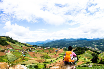 Man with backpack hiking in mountains Travel Lifestyle In the countryside northern, Thailand