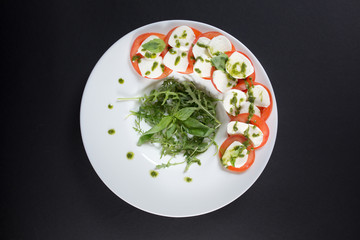 a very tasty salad of mozzarella, tomatoes, spinach and sauce