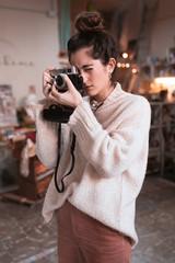 Photographer taking shots in workshop