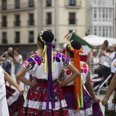 Rear view of mexican woman, folk dance group