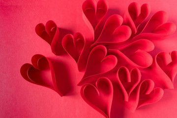 handmade Valentine paper craft red hearts in a group top view