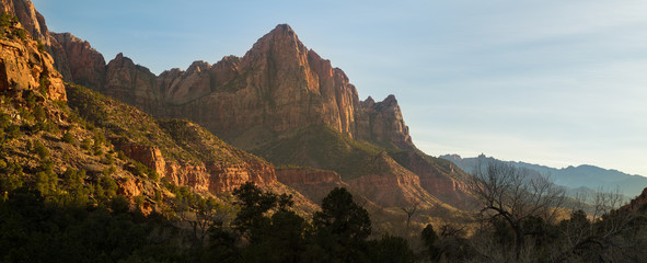 Panoramic sunset photograph of famed formation The Watchman in Zion National Park in southern Utah.
