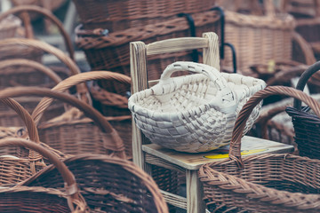 Obraz Hand-made wicker baskets sold at the bazaar for shopping or mushroom picking. - fototapety do salonu