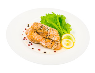 Dietary and healthy diet. Salmon steamed, lemon, green salad