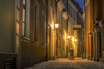 Riga Old town in winter covered with snow. Historical buildings, popular landmarks, authentic architecture. Small streets with cobblestone.
