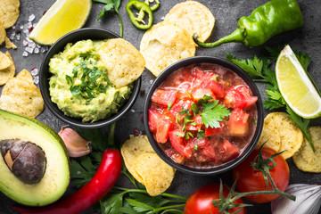Latinamerican food party sauce guacamole, salsa, chips.