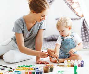 children creativity. mother and baby son drawing together
