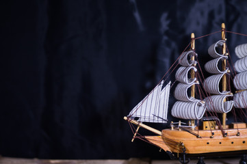 souvenir ship on a black background