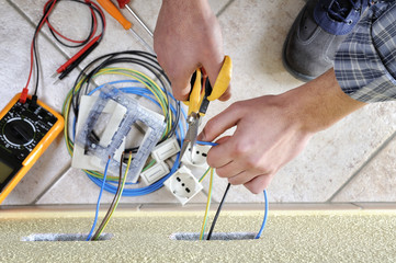 Electrician technician at work on a residential electric system