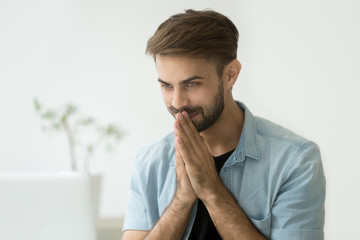 Happy young man pleased by online message or good news on laptop, surprised guy excited by new opportunity email offer looking at computer screen satisfied with achievement, motivated by win result