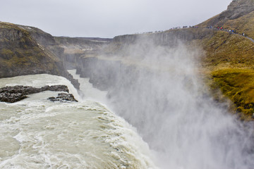 Looking over the Edge with Mist Rising Up Gullfoss Waterfall in Iceland