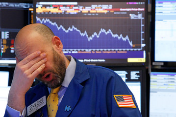 A trader reacts near the end of the day on the floor of the New York Stock Exchange in New York