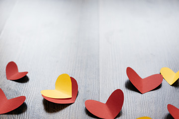 Valentine 's Day background, red and yellow hearts on wood texture