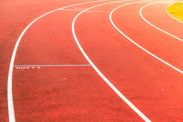Red running track in stadium.