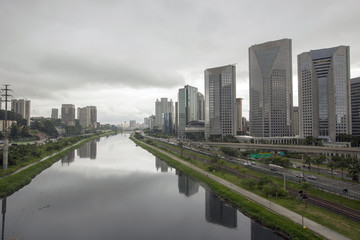 Buildings reflected in river waters