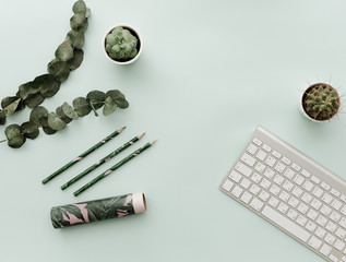Modern Hipster Flat Lay With Keyboard, Eucalyptus, cactus and supplies. Flat lay