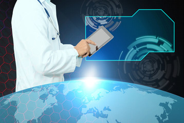 Doctor hand working smart digital tablet screen ,with virtual screen copy space .Medical technology concept,elements of this image furnished by NASA.