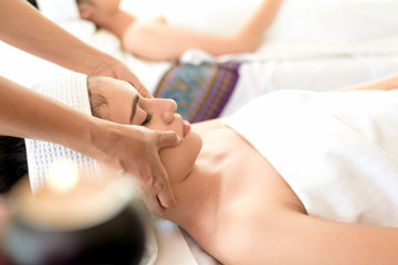 Young healthy asian woman lying relax in spa salon.Traditional Thai oriental aromatherapy and Massage beauty treatments.Recreation vitality wellness wellbeing  resort hotel lifestyle leisure.copyspace