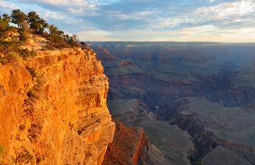 Fototapete - Sunrise at Mather Point, Grand Canyon National Park, Arizona. Photo Shows a Group of Tourists Watching Sunrise at Mather Point which is famous for Sunrise.