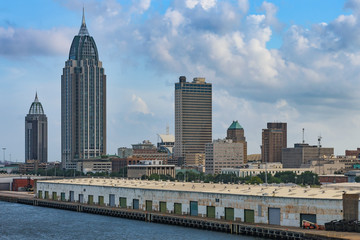 Downtown of Mobile, Alabama, USA and city docks as seeing from port harbour