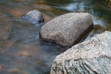 rock and stone in a rushing river