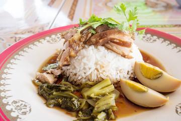 Stewed pork leg on cooked rice