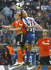 Hertha Berlin's Josip Simunic challanges Schalke 04's Ivan Rakitic their German Bundesliga soccer match in Berlin