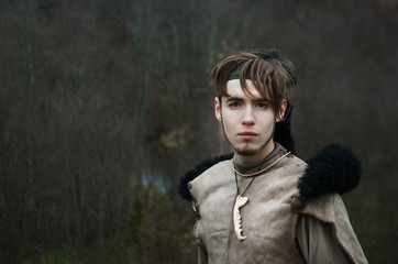portrait of a young man in a barbarian outfit