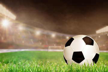 Outdoor Soccer Stadium With Football on Grass and Copy Space. Special lighting effect.
